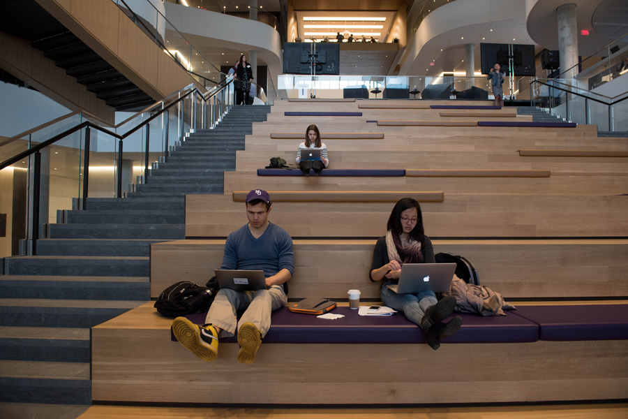Students sit on the stairways in the Kellogg School of Management Global Hub. While many praised the building for having several facilities open for students, Weinberg freshman Adam Davies expressed frustration over the shortage of gender-neutral bathrooms.