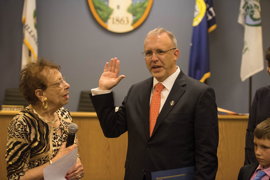 Former Mayor Lorraine Morton administers the oath of office to Mayor Steve Hagerty. Hagerty and other members of the 80th City Council were sworn into office Monday evening.
