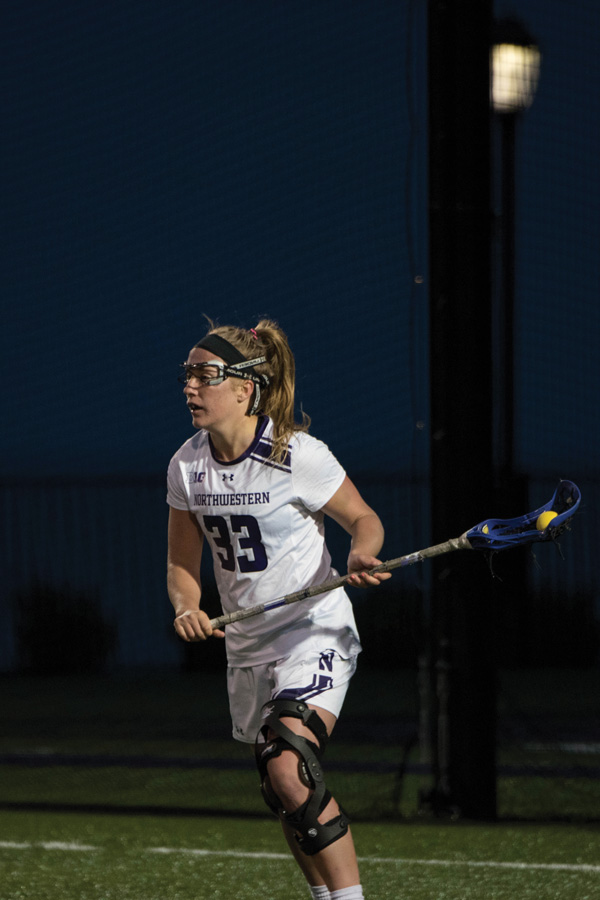 Shelby+Fredericks+cradles+the+ball.+The+junior+attacker%E2%80%99s+draw+control+efforts+will+be+key+in+Friday%E2%80%99s+Big+Ten+Tournament+game+against+Penn+State.