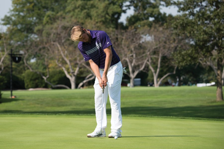 Andrew+Whalen+watches+his+putt+roll+past+the+hole.+The+senior+and+the+Wildcats+blew+a+huge+lead+in+the+NCAA+Regionals+on+Wednesday+and+saw+their+season+end.