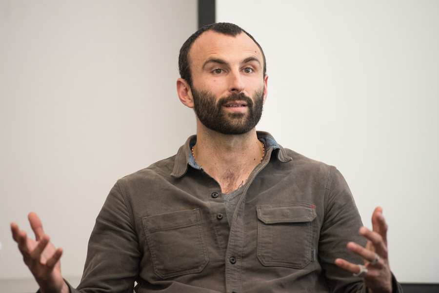 Multimedia+journalist+and+filmmaker+Jason+Motlagh+speaks+at+a+Medill+event+in+Fisk+Hall+on+Monday.+He+shared+his+experiences+as+an+international+crisis+reporter+with+students.+