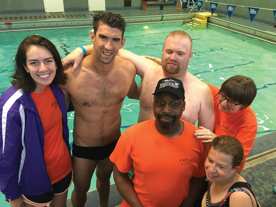 Michael Phelps poses with athletes at The Valentine Boys and Girls Club of Chicago. Phelps on Saturday helped train Evanston Special Recreation athletes.