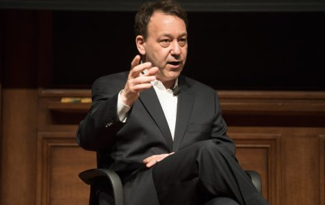 Director and producer Sam Raimi talks on Tuesday. He discussed mixing genres, such as horror and comedy, in his films.