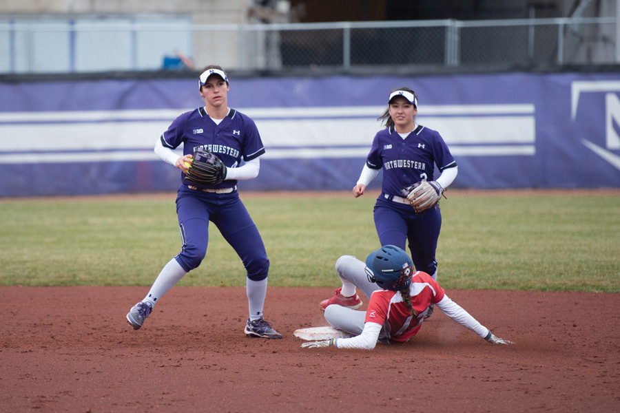 Marissa Panko (left) completes a double play. The junior infielder helped spark the Wildcats' offense against Purdue in the Big Ten Tournament.