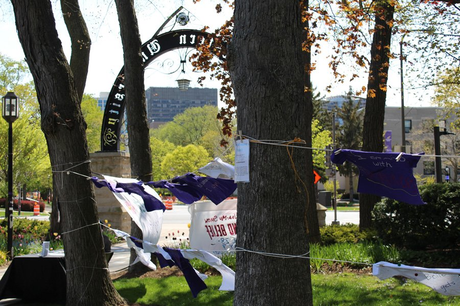 Shirts hang by The Arch as part of The Clothesline Project. A shirt containing profanity was found hanging on the public display on Wednesday morning.
