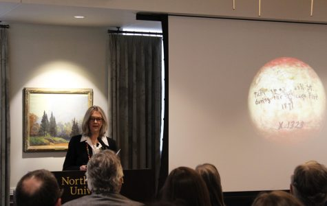 Visiting Prof. Pippa Skotnes speaks Monday in Scott Hall. Skotnes used a charred billiards ball from the Great Chicago Fire to explain her archival research on the San peoples.