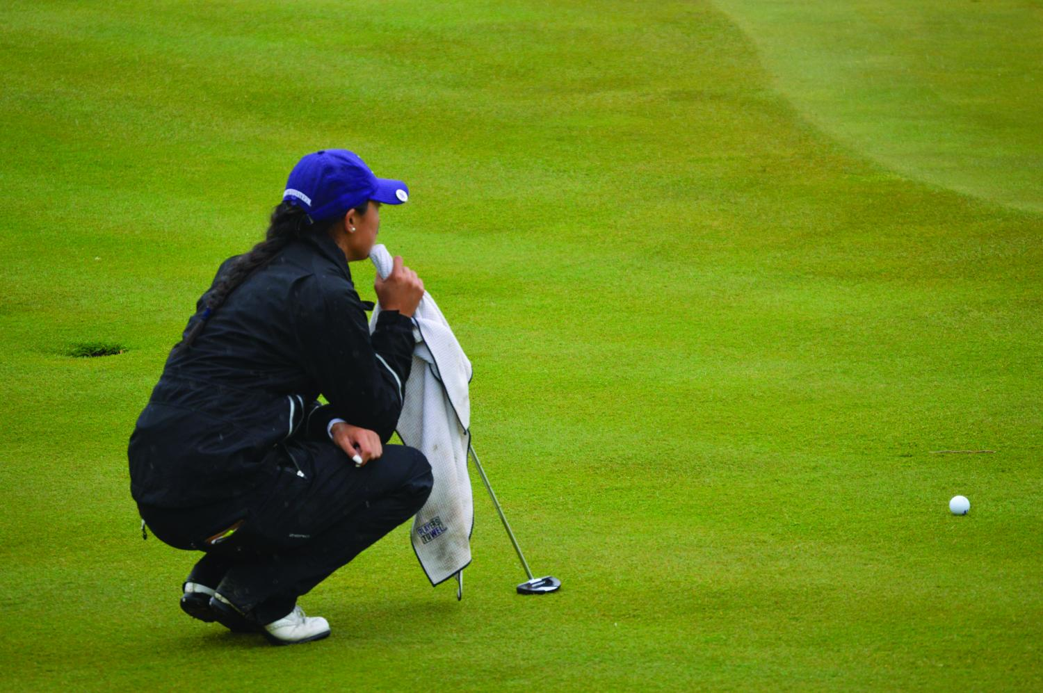 Janet Mao thinks through a putt. The sophomore and the Wildcats fell to Arizona State in the National Championship match Wednesday.