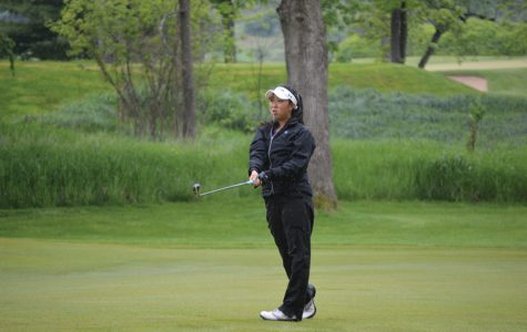Kacie Komoto watches her shot from the fairway. The senior and the Wildcats will resume their NCAA Championships semifinal Wednesday morning.