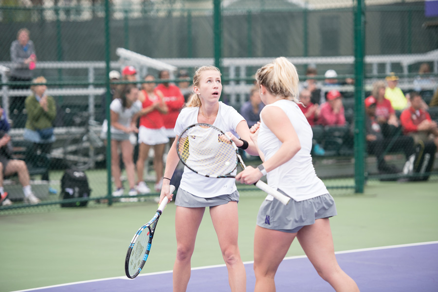 Juniors Maddie Lipp and Alex Chatt celebrate after winning a point. The doubles pair will head to Athens, Georgia for the NCAA Doubles Championship following the Cats' elimination from the NCAA Tournament.