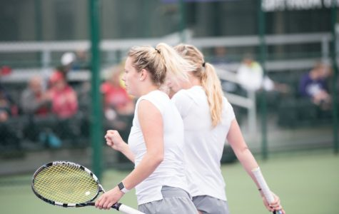 Alex Chatt (left) and Maddie Lipp chat between points. The juniors will play in the NCAA Doubles Tournament this week.