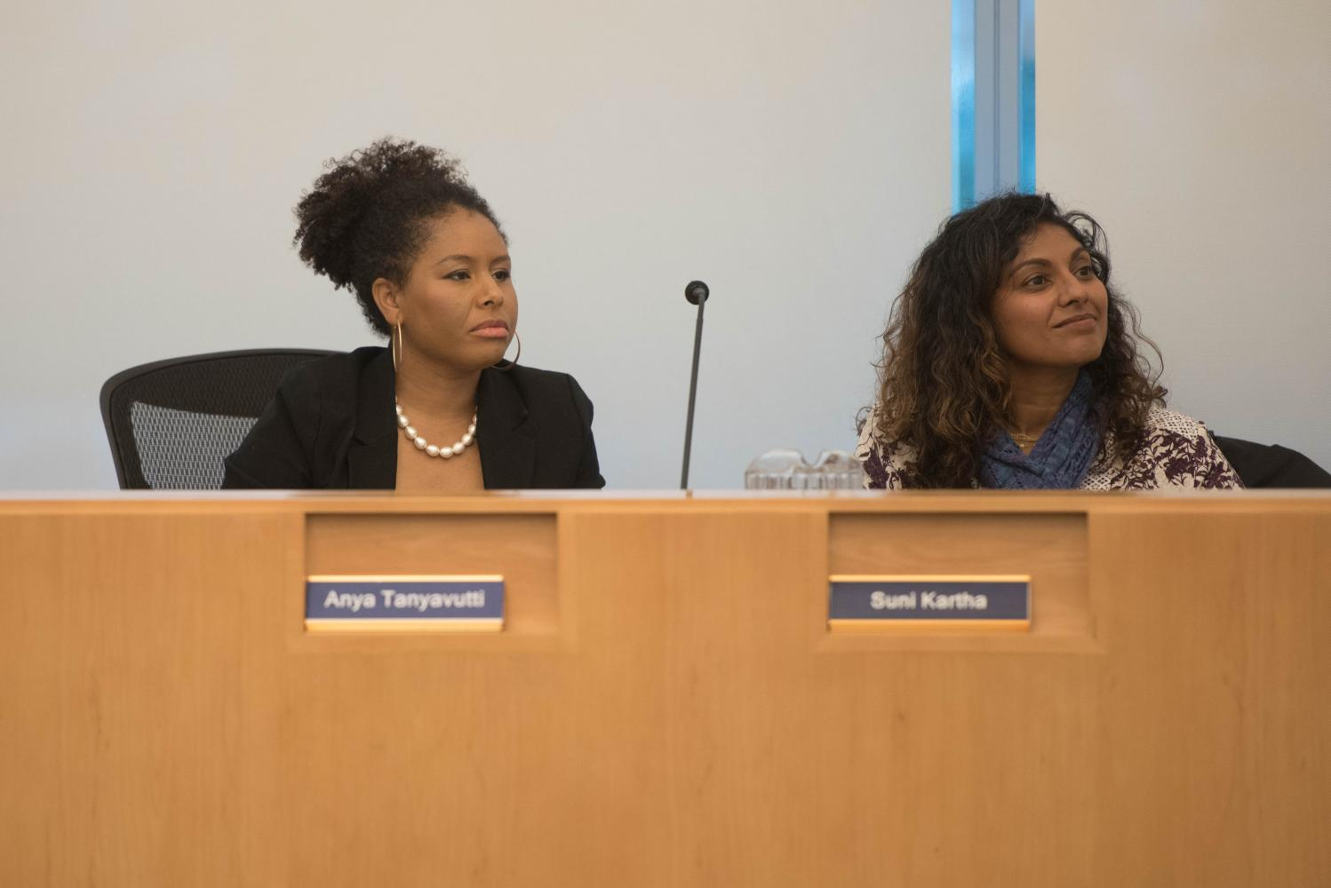 Evanston/Skokie District 65 school board vice president Anya Tanyavutti and president Suni Kartha watch a speaker at a board meeting. Tanyavutti and Kartha both voted in favor of the algebra consolidation plan Monday, which passed 5-1.