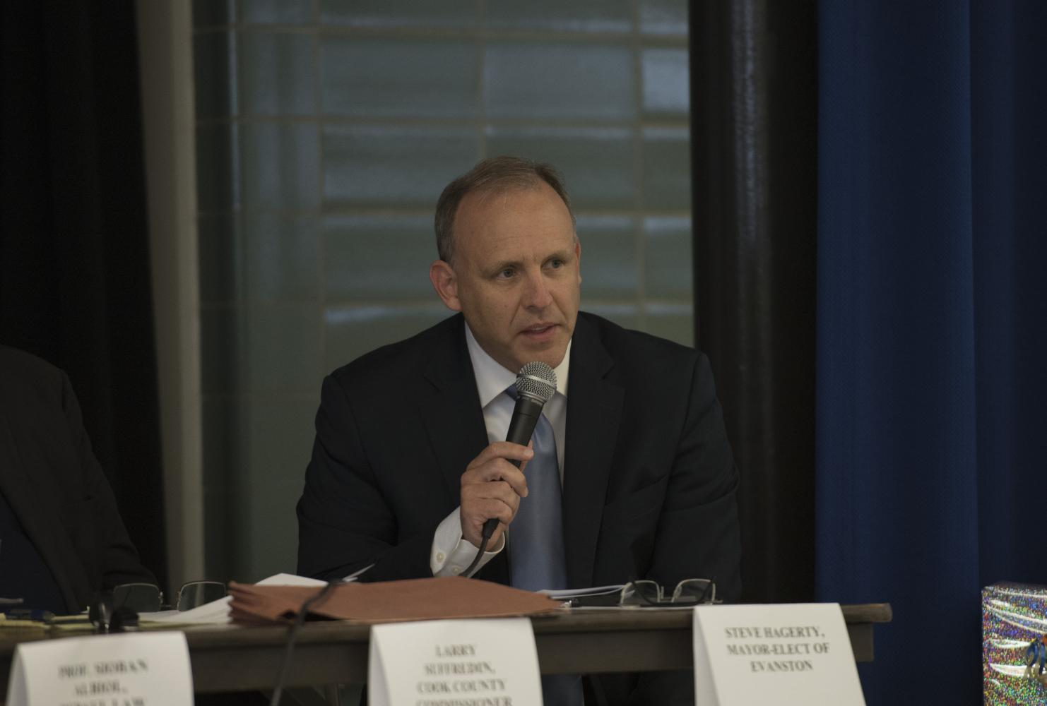 Evanston mayor Steve Hagerty speaks at a panel. Hagerty joined an effort by Chicago mayor Rahm Emanuel and 11 other mayors nationwide to post climate change information on their cities' websites starting Sunday.