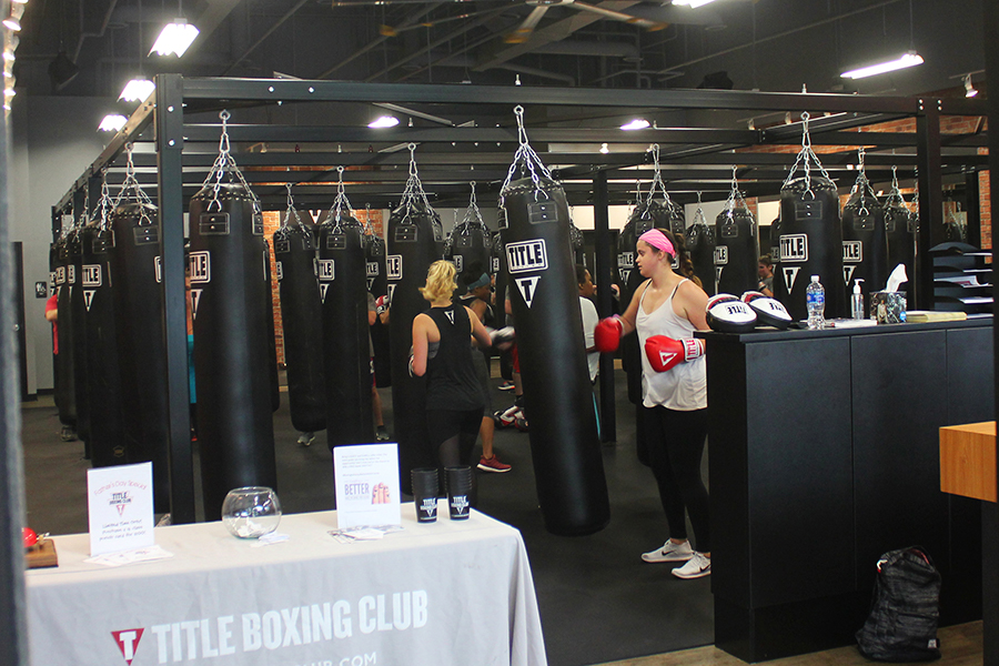 Customers+work+out+with+punching+bags+at+TITLE+Boxing+Club.+The+club%2C+which+opened+in+Evanston+in+April%2C+is+now+seeking+to+engage+more+with+the+Northwestern+student+body.