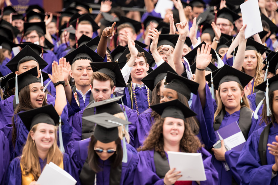 Graduates+of+the+Northwestern+Class+of+2017+stand+at+commencement.+Commencement+took+place+Friday+morning+at+Ryan+Field.