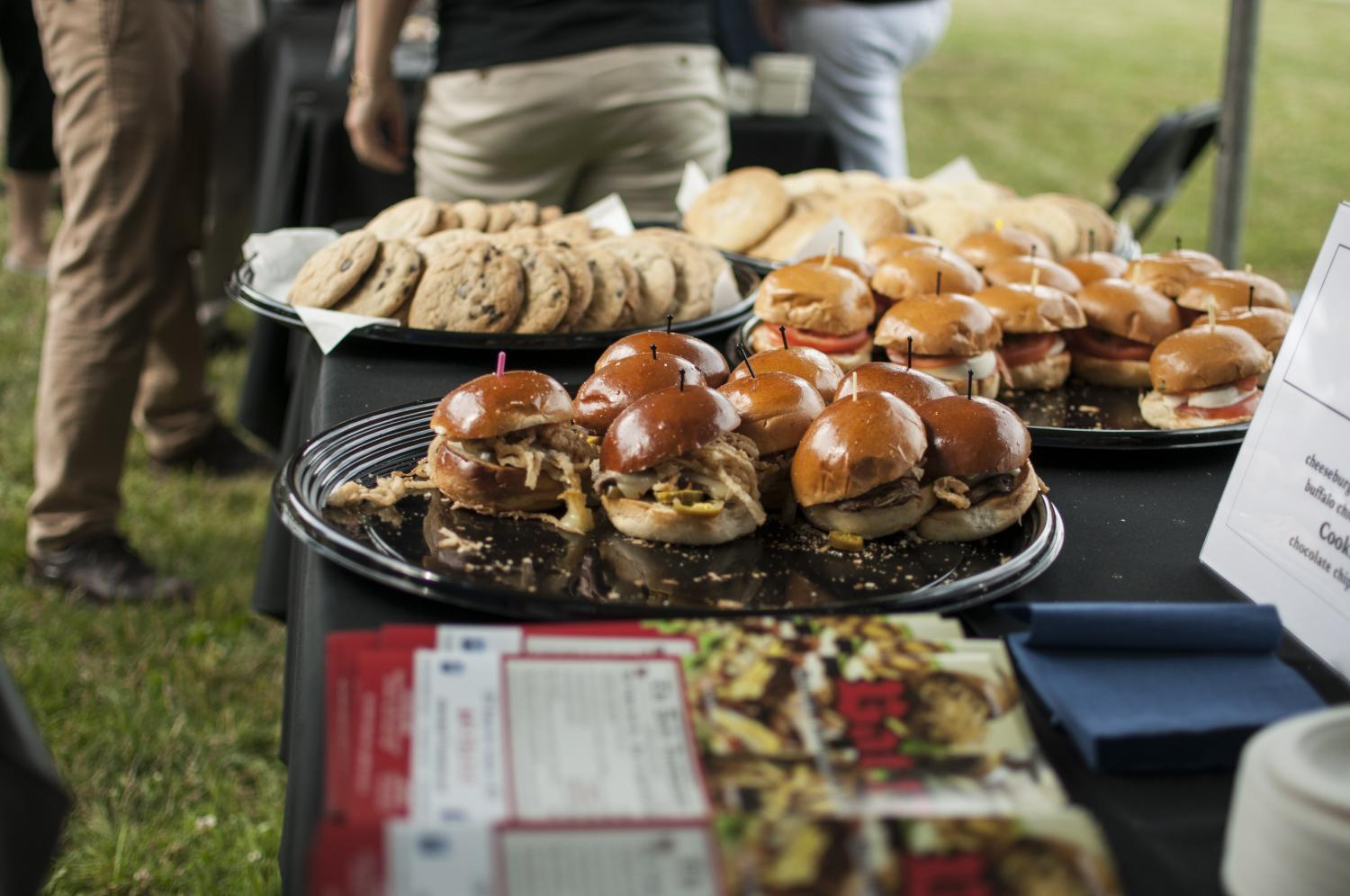 Sandwiches and cookies sit on a table outside the Evanston History Center. Evanston residents sampled food from numerous local restaurants at the Taste of Evanston event on Sunday.
