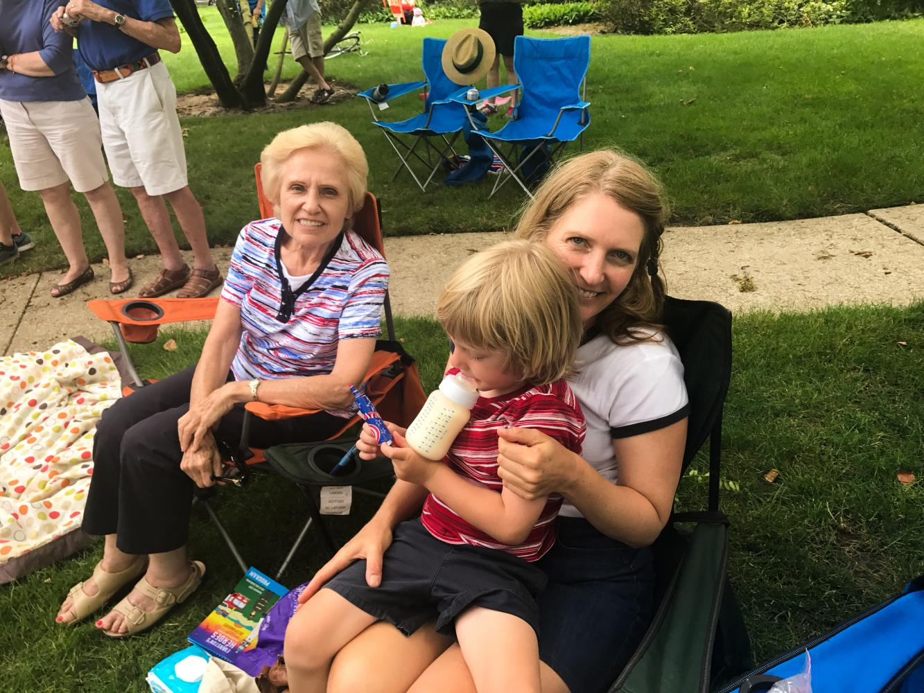 "Karen Gliwa enjoys the parade with her 3-year-old son and her mother. ""Fourth of July to me is about family and independence,"" she said."