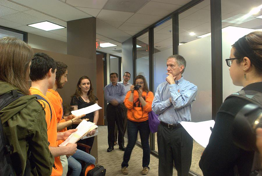 Members of Fossil Free NU read a statement to chief investment officer Will McLean in 2015. The University recently created a socially responsible investment committee to improve communication with the Board of Trustees.
