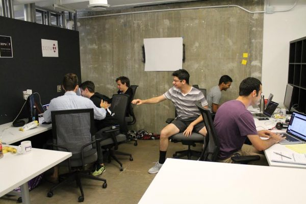 The Zcruit team works on its software platform. The company will operate out of The Garage at Northwestern this summer, while it works to expand its reach.