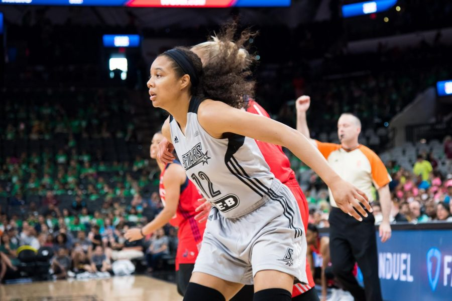 Nia Coffey boxes out an opponent for a rebound in San Antonio's July 25 game against the Washington Mystics. Coffey and the Stars have both struggled this season.