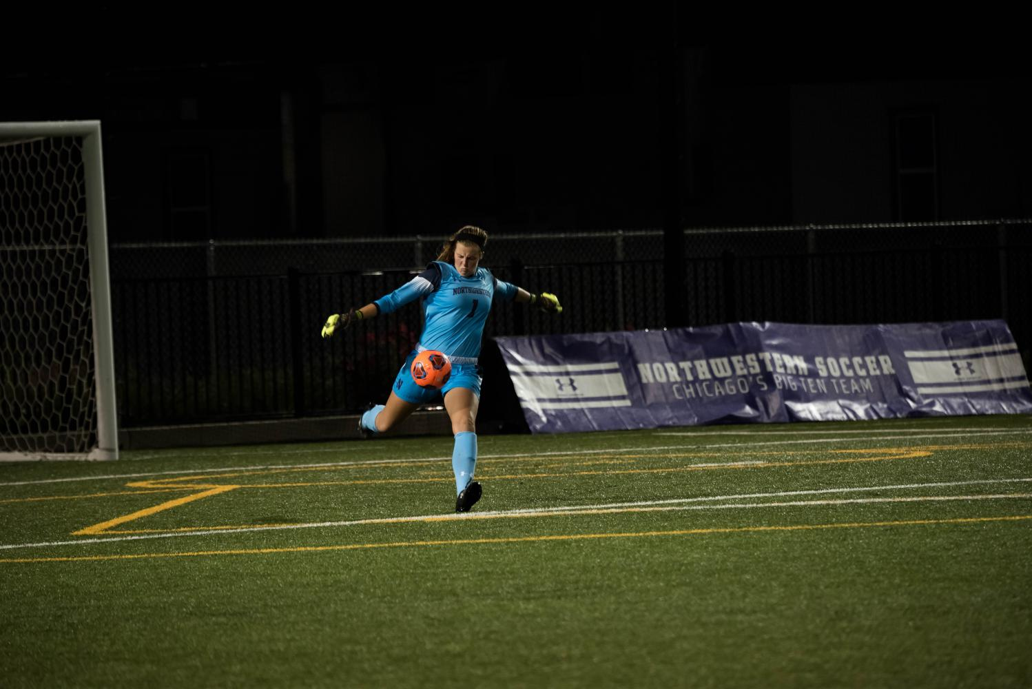 Lauren Clem kicks the ball upfield in a game last year. Clem's clean sheet helped the Wildcats to a season-opening win over DePaul on Friday.