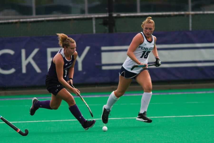 Elena Curley carries the ball. The senior midfielder and the Wildcats won twice in recent days, but took an ugly loss against Connecticut.