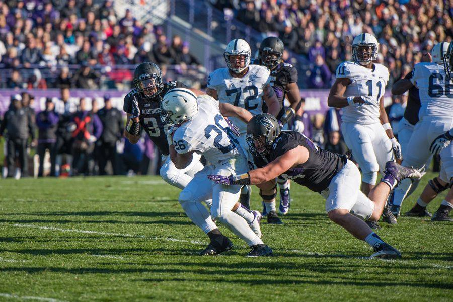 Dean Lowry extends to make a tackle in Northwestern's win over Penn State in November 2015. Lowry, now entering his second season in the NFL, is seeking to find similar success with the Packers.