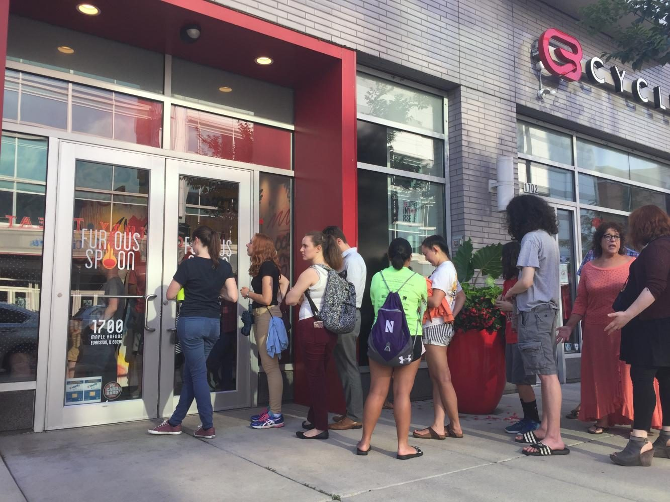 Customers+wait+outside+Furious+Spoon+for+its+Thursday+5+p.m.+grand+opening.+The+ramen+restaurant+is+located+at+Maple+Avenue+and+Church+Street+downtown.