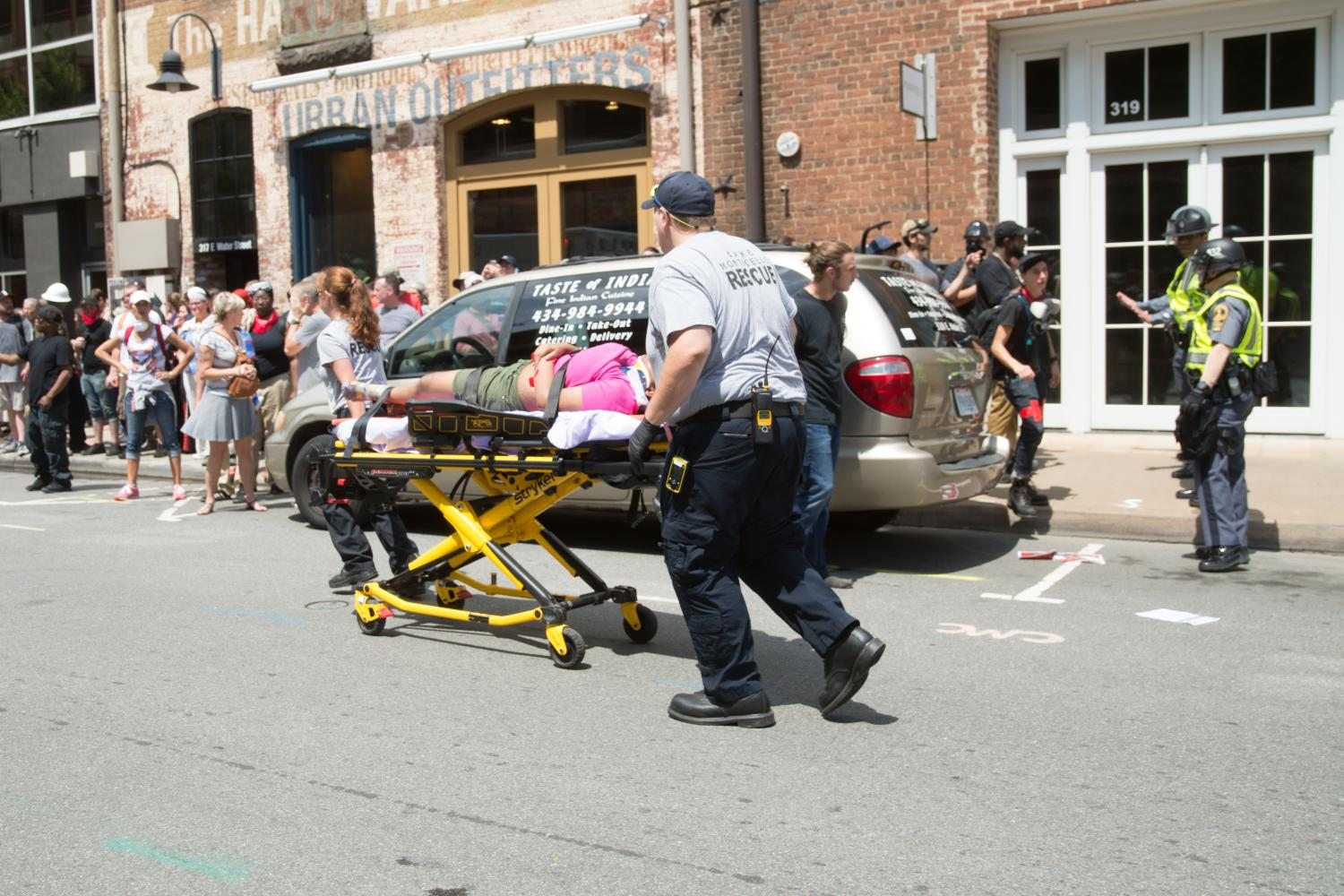 An injured person Saturday in Charlottesville, Virginia, after a white supremacist rally became violent. Local officials have denounced the rally and President Donald Trump's rhetoric.