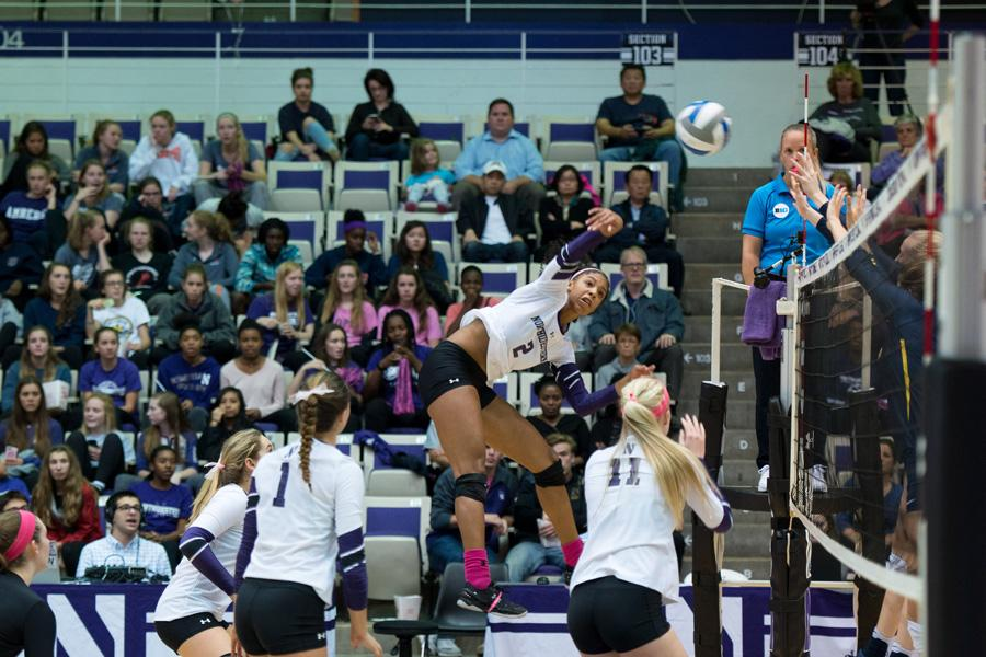 Symone+Abbott+swings+for+a+kill.+The+senior+is+among+a+trio+of+players+expected+to+lead+the+Wildcats+this+season.
