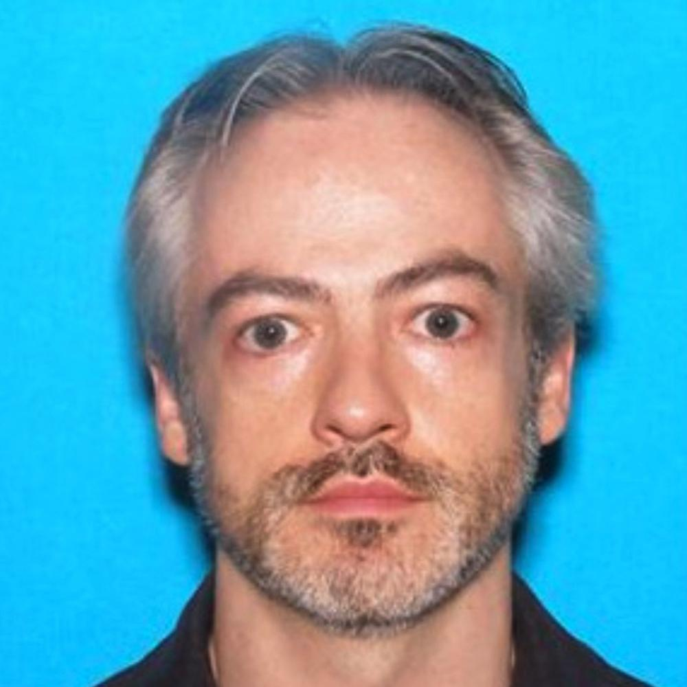 Northwestern Professor Wanted In High-Rise Murder Returns To Chicago