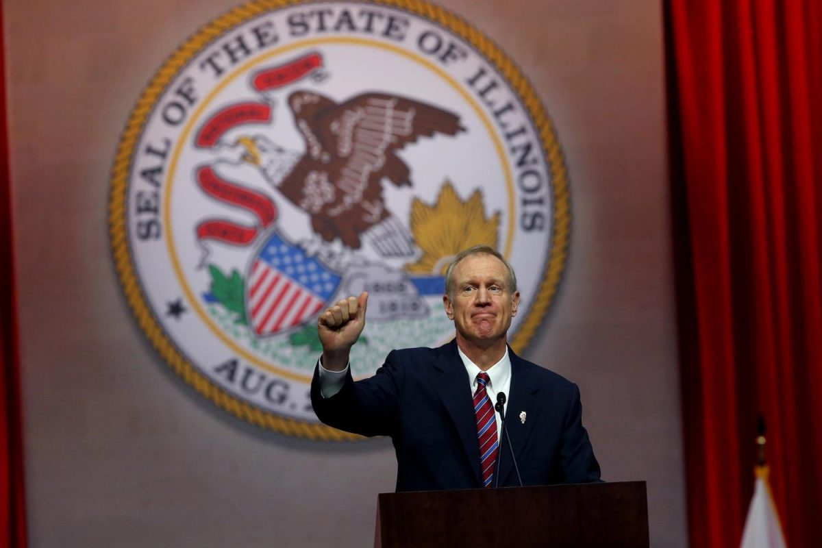 Gov.+Bruce+Rauner+gives+a+thumbs+up+after+his+first+speech+as+governor+on+Jan.+12%2C+2015%2C+at+the+Prairie+Capital+Convention+Center+in+Springfield%2C+Ill.+Rauner+said+he+is+not+sure+whether+he+will+veto+an+abortion+bill%2C+and+his+indecision+has+made+state+Democrats+hopeful.+%0A