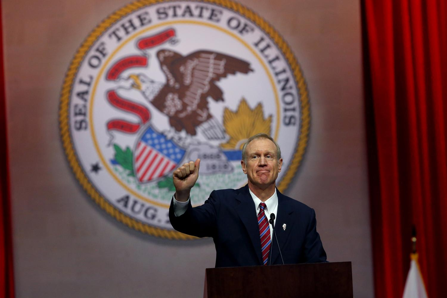 Gov. Bruce Rauner gives a thumbs up after his first speech as governor on Jan. 12, 2015, at the Prairie Capital Convention Center in Springfield, Ill. Rauner said he is not sure whether he will veto an abortion bill, and his indecision has made state Democrats hopeful.