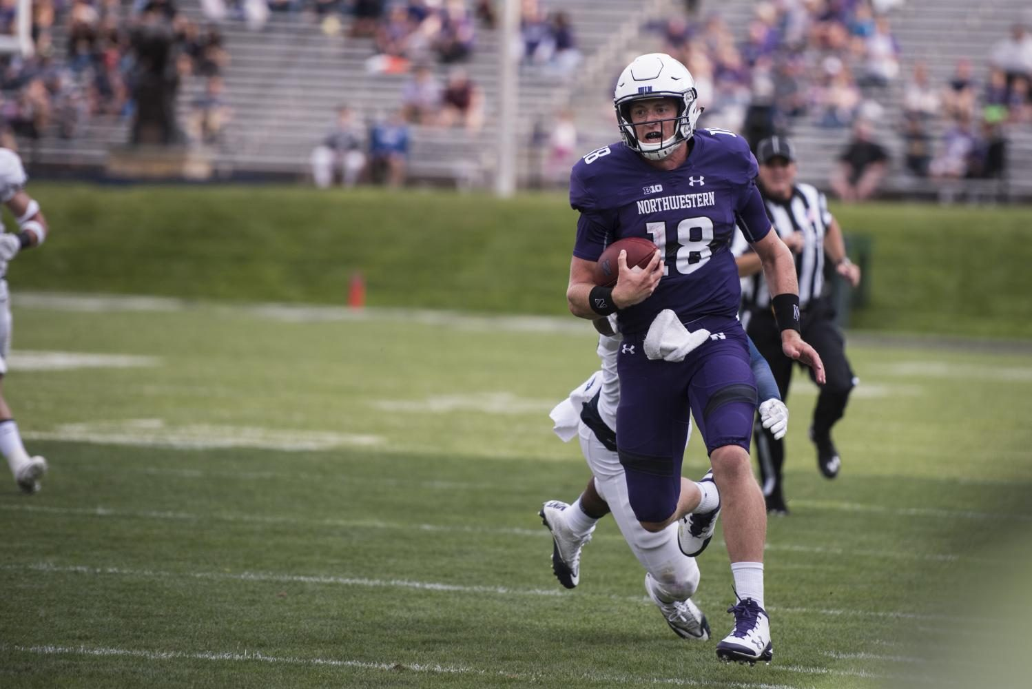 Clayton+Thorson+carries+the+ball.+The+junior+quarterback+tossed+for+352+yards+in+Northwestern%27s+win+over+Nevada+on+Saturday.+
