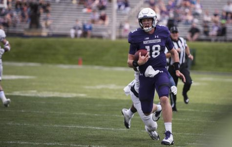 Clayton Thorson carries the ball. The junior quarterback tossed for 352 yards in Northwestern's win over Nevada on Saturday.