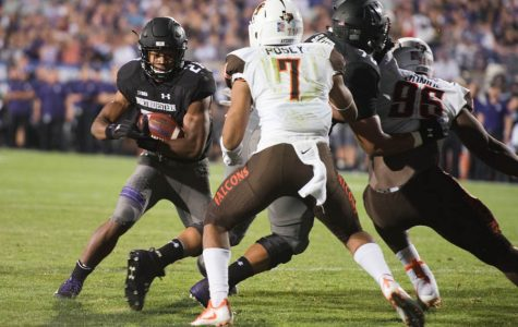Justin Jackson cuts through the Bowling Green defense. The senior running back found the end zone three times Saturday, matching a career high.