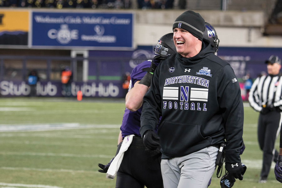 Coach Pat Fitzgerald smiles during last year's Pinstripe Bowl. Northwestern's football program was valued at approximately $163 million in a recent analysis.