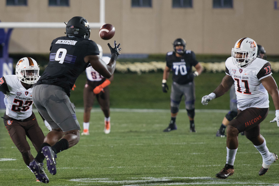 "Garrett Dickerson catches a pass. The senior said Northwestern held a ""constructive"" meeting in which it discussed entering Saturday's contest with locked arms."