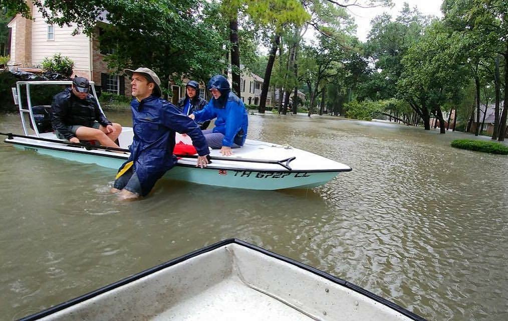 Weinberg senior Elaine Parizot's father (middle) and neighbors help rescue stranded residents in Houston with their personal boats. Parizot's neighborhood flooded after Hurricane Harvey caused Houston's two reservoirs to overflow.