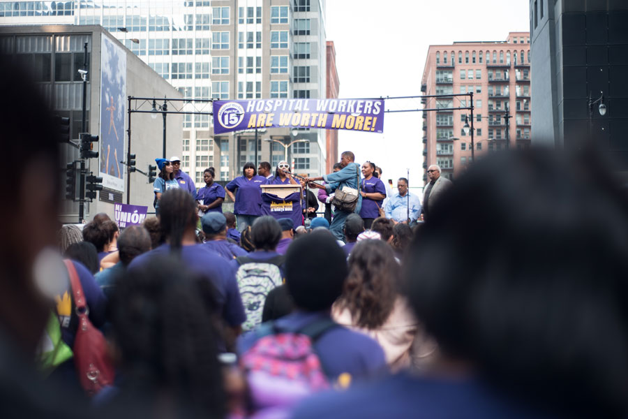 Union members speak to the crowd at a Labor Day protest in Chicago. Hundreds of fast food workers, hospital employees and airport workers advocated for higher wages and benefits in a series of walkouts and marches.