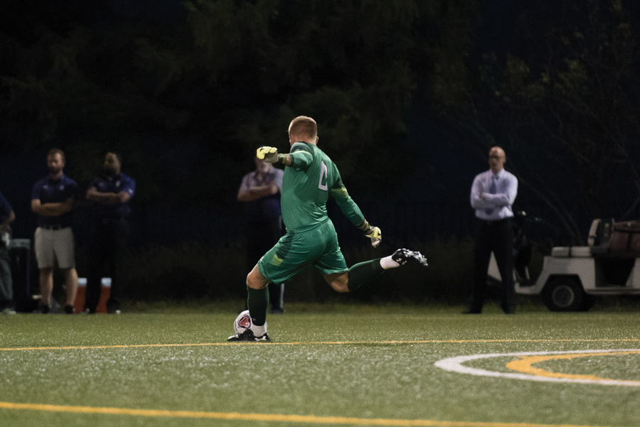 Robbie White kicks the ball. The junior goalkeeper and the Wildcats fell to No. 22 Michigan on Sunday.