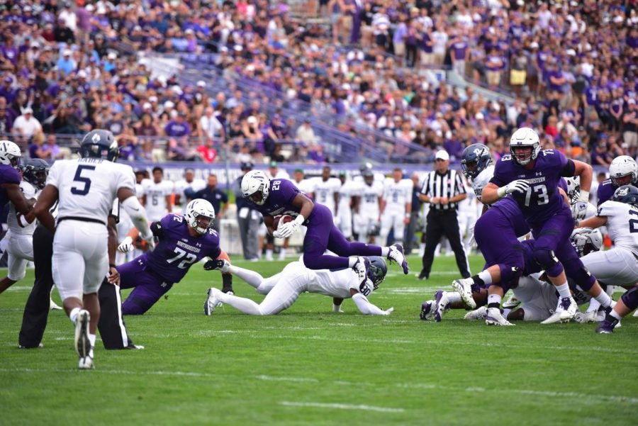 Jeremy Larkin dives forward. The redshirt freshman and the Wildcats pulled out a win against Nevada on Saturday.