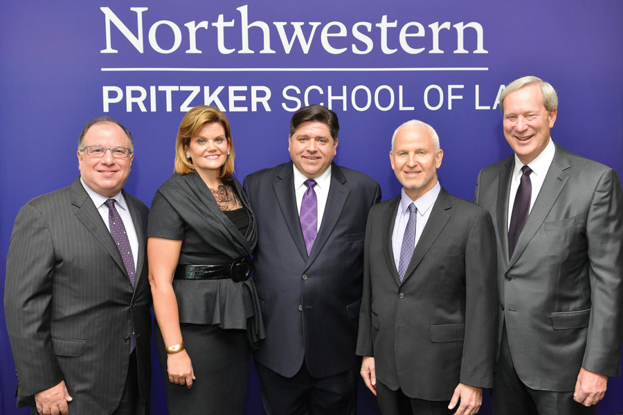 Pritzker School of Law Dean Daniel Rodriguez, M.K. Pritzker, J.B. Pritzker, University President Morton Schapiro and former Board of Trustees chairman William Osborn pose for a photo at the announcement of the Pritzker family's $100 million donation to the law school. Rodriguez plans to step down as dean at the end of this academic year.