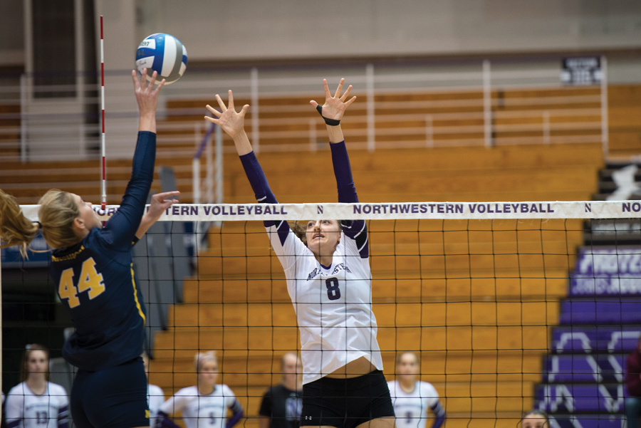Gabrielle+Hazen+goes+up+for+a+block.+The+senior+middle+blocker+tallied+eight+kills+in+Northwestern%E2%80%99s+loss+to+Illinois+on+Saturday.