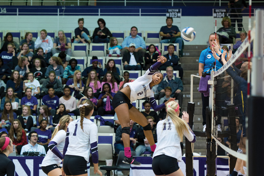 Symone+Abbott+jumps+for+a+spike.+The+senior+outside+hitter+and+the+Wildcats+went+2-1+at+the+VCU+Invitational.+