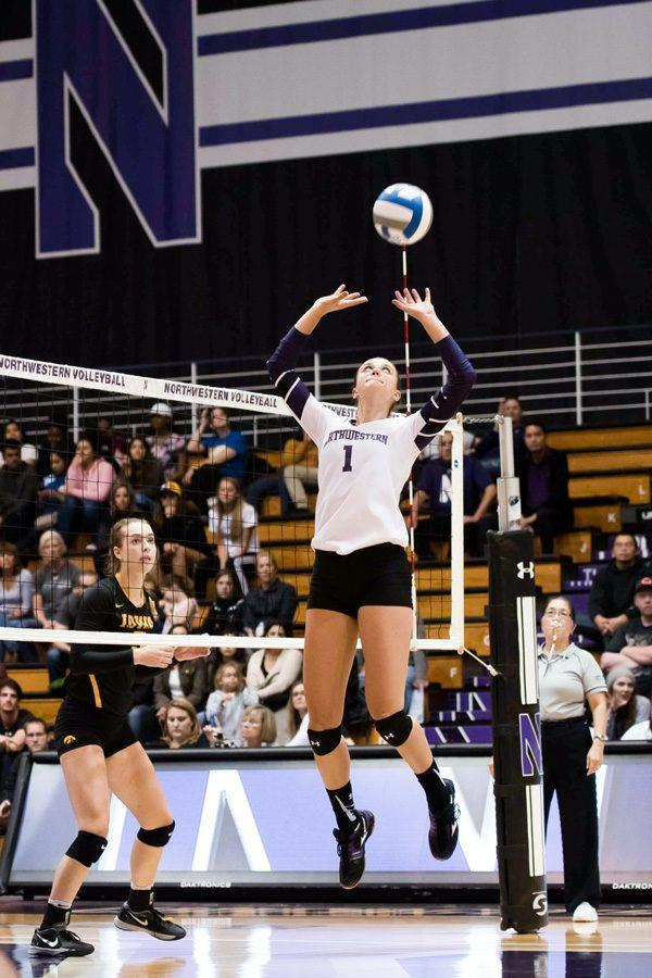 Taylor Tashima sets the ball. The senior led the Wildcats to an undefeated weekend at the DePaul Invitational and was named tournament MVP.