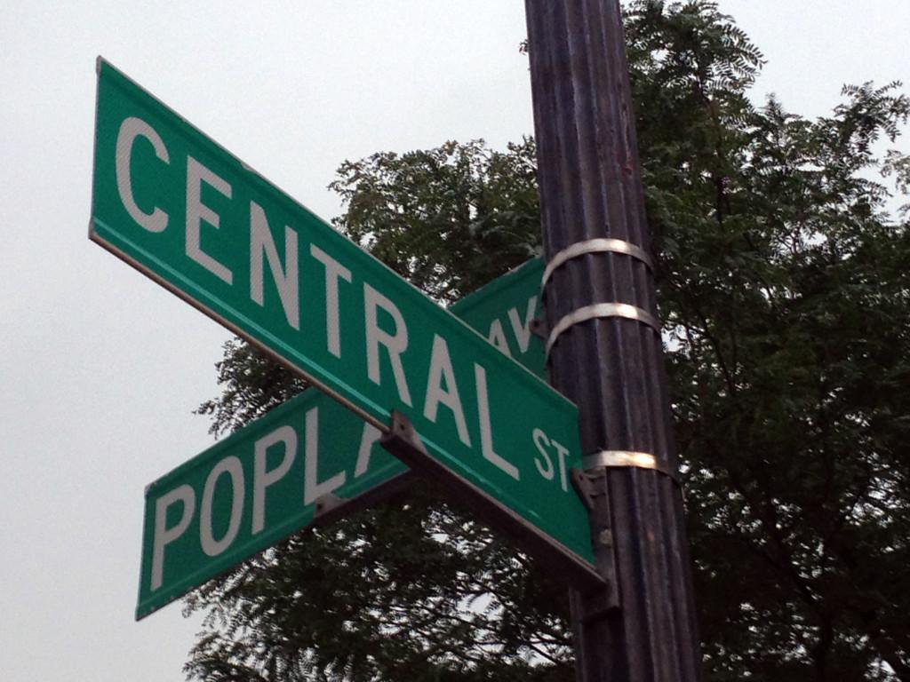 Street signs at the intersection of Central Street and Poplar Avenue. Work began Sept. 18 to rebuild an underground manhole and install new cable and conduit near the streets.