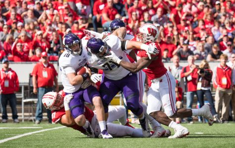 Clayton Thorson gets tackled. Wisconsin sacked the junior quarterback eight times Saturday afternoon.