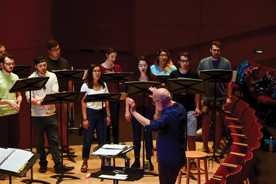 Donald Nally rehearses with the Bienen Contemporary/Early Vocal Ensemble in preparation for their concert featuring the works of Eric Whitacre. The group will perform with the composer at the University of Chicago's Rockefeller Memorial Chapel on Oct. 13.