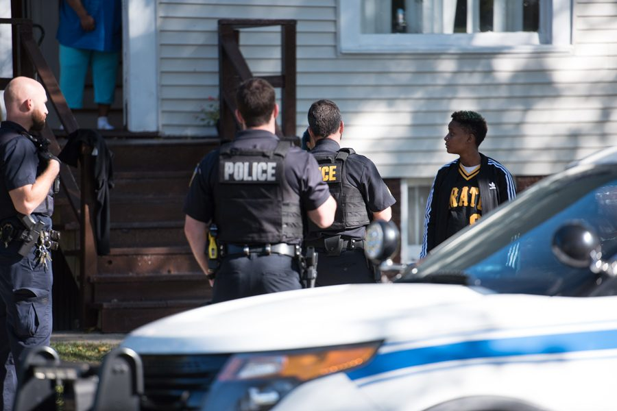 Several community members stand outside a home on Hovland Court in west Evanston. A 19-year-old Evanston woman was charged with battery in the 1800 block of Hovland Court after allegedly punching a Skokie woman in the face.