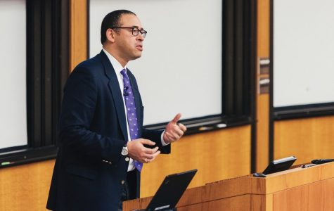 """Provost Jonathan Holloway speaks at Faculty Senate. Holloway said the proposed academic calendar changes may create a """"more humane Fall Quarter"""" and increase the length of spring break."""
